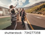group of man and women on road... | Shutterstock . vector #734277358