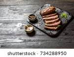 sliced grilled roast beef with... | Shutterstock . vector #734288950