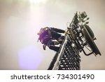 telecom worker climbing antenna ... | Shutterstock . vector #734301490