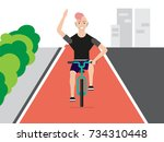 cheerful young man riding a...   Shutterstock .eps vector #734310448