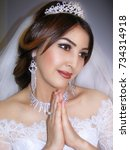 Small photo of girl in wedding garb