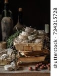 Small photo of Variety of French Cheeses and Another Provision in a Dusty Pantry, copyspace for your text