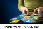 hand holding tablet device with ... | Shutterstock . vector #734337100
