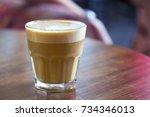 cappuccino in a glass beaker  ...   Shutterstock . vector #734346013