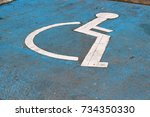 Small photo of Wheelchair Symbol of Accessibility ADA Signs on parking lot