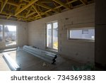 interior of an unfinished house | Shutterstock . vector #734369383