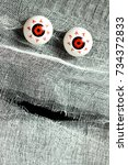 red eyes and white bandages on... | Shutterstock . vector #734372833