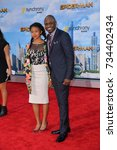 "Small photo of LOS ANGELES, CA - June 28, 2017: Wayne Brady & Maile Masako Brady at the world premiere for ""Spider-Man: Homecoming"" at the TCL Chinese Theatre"