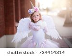 adorable girl in unicorn... | Shutterstock . vector #734414314