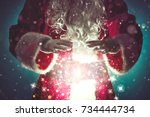 santa claus with magic... | Shutterstock . vector #734444734