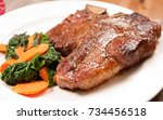 t bone steak with spinach and... | Shutterstock . vector #734456518