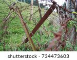 barb wire fence at... | Shutterstock . vector #734473603