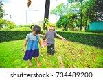 three happy asian children of... | Shutterstock . vector #734489200