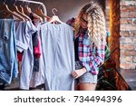 positive blonde female in black ... | Shutterstock . vector #734494396