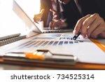 business team meeting present... | Shutterstock . vector #734525314