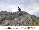 young man riding a bike on... | Shutterstock . vector #734531248