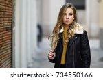 blonde woman in urban... | Shutterstock . vector #734550166