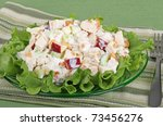 Chicken salad with apple pieces on top of lettuce - stock photo