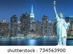 the statue of liberty with... | Shutterstock . vector #734563900