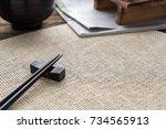chopsticks on won bamboo mat... | Shutterstock . vector #734565913