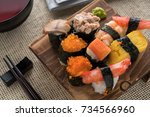 mix of sushi and rolls macro.... | Shutterstock . vector #734566960