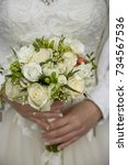 the bride is holding a bouquet ... | Shutterstock . vector #734567536