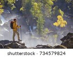 hiker hiking with backpack... | Shutterstock . vector #734579824