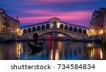 gondola near rialto bridge in... | Shutterstock . vector #734584834