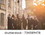 successful graduates in...   Shutterstock . vector #734589478