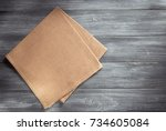 cloth napkin on wooden table... | Shutterstock . vector #734605084