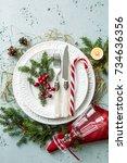 elegant christmas table setting ... | Shutterstock . vector #734636356