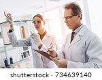 two scientists are working in...   Shutterstock . vector #734639140