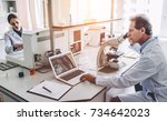 two scientists are working in... | Shutterstock . vector #734642023