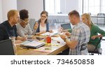 young diverse coworkers posing...   Shutterstock . vector #734650858