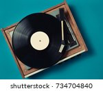 retro vinyl player on a blue... | Shutterstock . vector #734704840