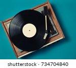 retro vinyl player on a blue... | Shutterstock . vector #734704840