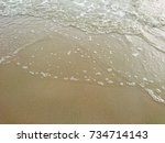 sand and sea blurry background  | Shutterstock . vector #734714143