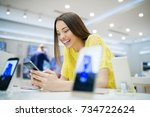 buying new smart phone at tech...   Shutterstock . vector #734722624