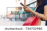 black friday  woman using... | Shutterstock . vector #734732980