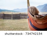 Small photo of Woman resting in hammock outdoors. Rest in the open air.