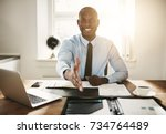 smiling young african executive ... | Shutterstock . vector #734764489