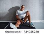 mature man in sportswear...   Shutterstock . vector #734765230