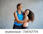 two young women in sportswear... | Shutterstock . vector #734767774
