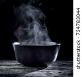 steam of hot soup in a soup... | Shutterstock . vector #734783044