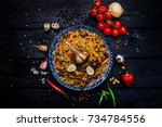 pilaf and ingredients on plate... | Shutterstock . vector #734784556