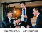 a group of men are businessmen... | Shutterstock . vector #734803483