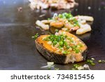 the grilled salmon steak with... | Shutterstock . vector #734815456
