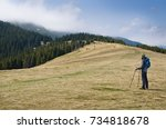 man is hiking in the autumn ... | Shutterstock . vector #734818678
