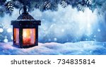 Small photo of Christmas Lantern On Snow With Fir Branch In Evening Scene