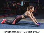 slim  bodybuilder girl  does... | Shutterstock . vector #734851960